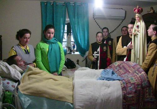 Visita a doentes, com a Imagem do Imaculado Coração de Maria